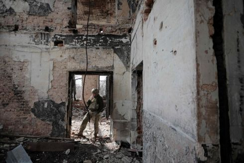 FRESH FIGHTING: A Ukrainian soldier in a building near the front line in the conflict with Russia-backed separatists, in the  town of Pisky, near Donetsk, eastern Ukraine. President Volodymyr Zelensky has invited Russian leader Vladimir Putin to meet in the war-torn region, stressing that millions of lives were at stake amid fresh fighting in the separatist conflict. Photograph: Aleksey Filippov/AFP/Getty