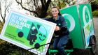 Dublin postwoman Laura Fitzsimons: An Post plans to help 30,000 homeowners retrofit their homes, have 2,000 electric vehicles  and spend €100 million on sustainability. Photograph:  Maxwells