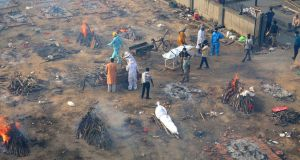 Multiple funeral pyres of  patients who died of Covid-19  are seen burning at a ground that has been converted into a crematorium for mass cremation of coronavirus victims, in New Delhi. Photograph: AP Photo