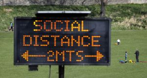 Signs in the Phoenix Park on social distancing. File photograph: Crispin Rodwell/ The Irish Times