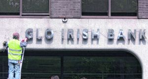 A workman removes the Anglo Irish Bank signage and lettering from its former head office in St Stephen's Green Dublin in 2011. Photograph: Bryan O'Brien