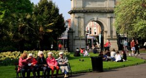 People enjoying the good weather in St Stephens Green, Dublin. Photograph: Gareth Chaney/Collins