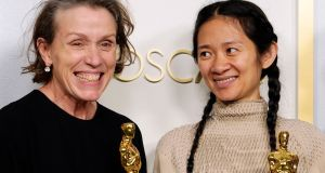 Frances McDormand and Chloe Zhao, winners of Best Picture and Best Actress for Nomadland, in Los Angeles. Photograph: Chris Pizzello-Pool/Getty Images