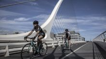 Cyclists cross the Samuel Beckett bridge in Dublin in August 2020. Photograph: Finbarr O'Reilly/Getty Images