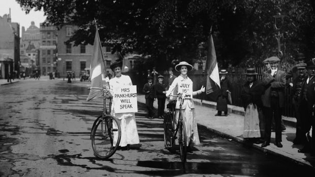 Members of the suffragette movement on their bicycles in July 1914 carrying signs advertising a meeting where militant campaigner Emmeline Pankhurst will speak. Photograph: Hulton-Deutsch Collection/Corbis via Getty Images