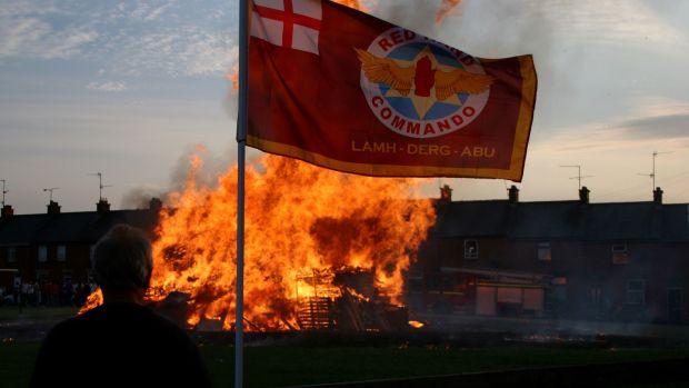 A loyalist paramilitary flag at a July 11th bonfire in Banbridge, Co Down