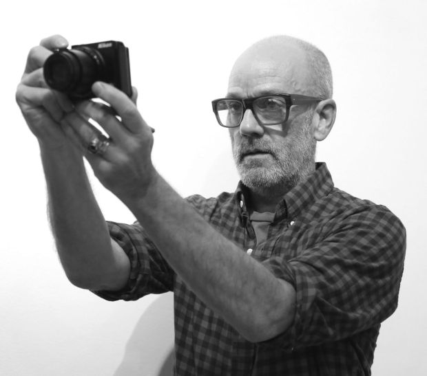 Michael Stip takes a photograph: he spends his time as a visual artist since REM. Photograph: Adam Berry/Getty