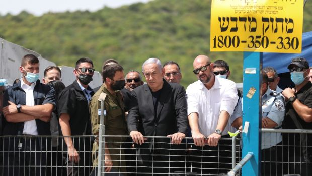 Israeli Prime Minister Benjamin Netanyahu visits Mount Meron, northern Israel, where dozens of people were killed and injured. Photograph: Ronen Zvulun/EPA