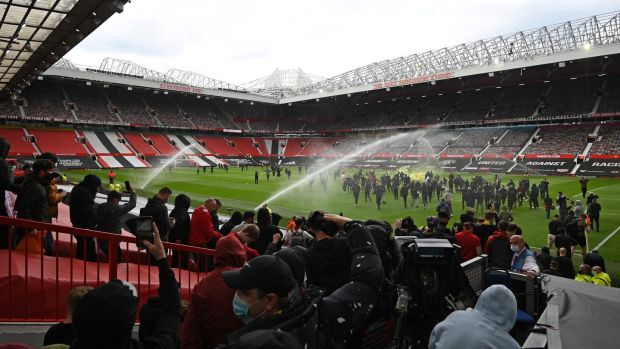 Supporters broke into the ground. Photo: Oli Scarff/AFP via Getty Images