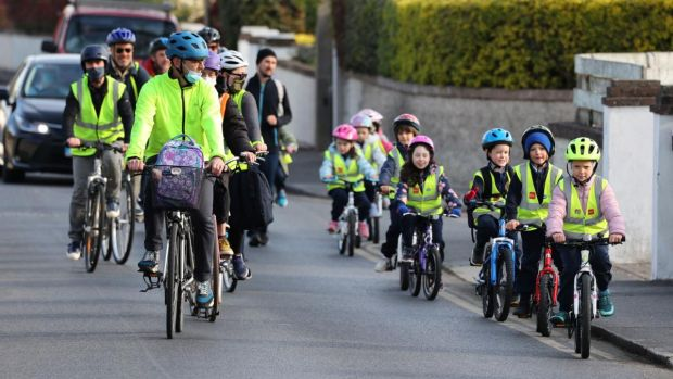 Children cycle to school in a convoy with parents including Ross Kinsella, heading for Gaelscoil na Fuinseoige in Finsbury Park, Dundrum. Photograph: Nick Bradshaw