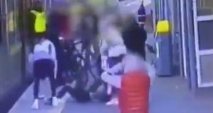"Gardaí are investigating an ""incident of assault"" at Howth Junction Dart Station, where a woman fell onto train tracks. Footage shows her being pulled clear of the train."