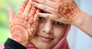 CRUINNIÚ NA NÓG: Zahra Syed (13) shows off henna body art created by herself and her sister at Airfield Estate, Dundrum, Dublin, for the launch of Creative Ireland's Cruinniú na nÓg 2021. The event, running on June 12th, will be a day of free creative activity for children and young people under the age of 18. See cruinniu.creativeireland.gov.ie. Photograph: Mark Stedman