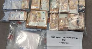 Gardaí have seized €35,000 worth of cocaine and €140,000 in cash from a house in Kilmore, Dublin 5.