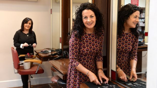 Dee Gallagher and Marie O'Boyle, prepare to reopen Studio One, hair salon on William St, Tullamore. Photograph: Dara Mac Dónaill