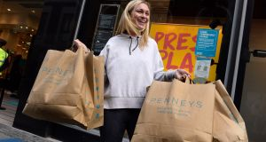 SPENDING PENNEYS: Laura Johnston, of Ringsend, leaves Penneys, Mary Street, Dublin, as non-essential retail opened for click-and-collect and appointment-only shopping as part of a major easing of Covid-19 lockdown restrictions. Photograph: Dara Mac Dónaill