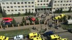 Ambulances and police cars gather outside a school in the aftermath of a shooting in Kazan, Russia. Photograph: Anton Raykhshtat/EPA