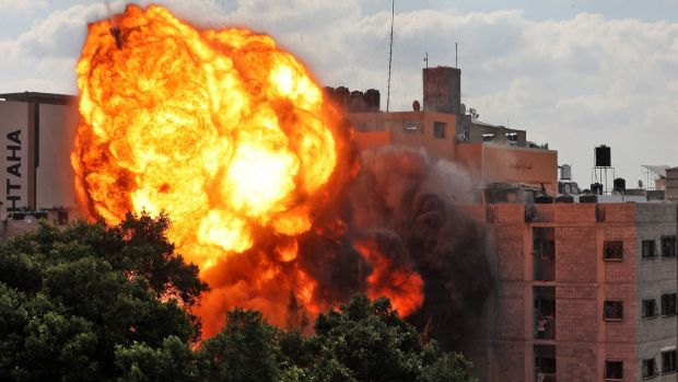 A ball of fire engulfing the Al-Walid building which was destroyed in an Israeli air strike on Gaza city early on Thursday. Photograph: AFP via Getty Images
