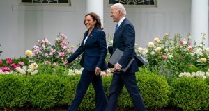 US vice president Kamala Harris and president Joe Biden walk away after Mr Biden made remarks on new Covid-19 advice from the  Centres for Disease Control. Photograph: Tasos Katopodis/EPA/Pool.