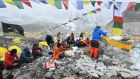 Mountaineers, Sherpas and team expedition members  at Everest base camp in early May. Photograph:  Prakash Mathema/AFP via Getty Images