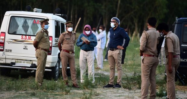 Police and administrative officials  inspect a cremation ground on the banks of Ganges River, where suspected bodies of Covid-19 coronavirus victims appeared to be partially buried. Photograph: Sanjay Kanojia/AFP via Getty
