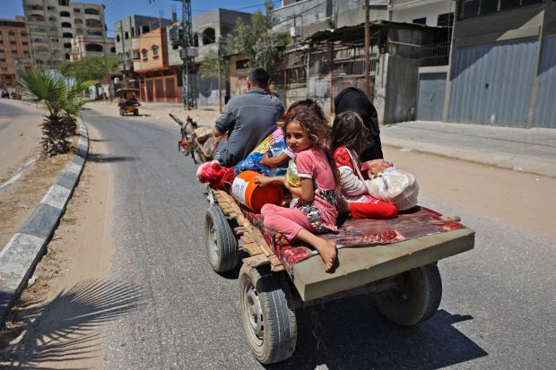 Members of a Palestinian family flee Israeli air strikes on a carriage pulled by a donkey in Beit Lahya in the northern Gaza Strip. Photograph: Mohammed Abed/AFP via Getty