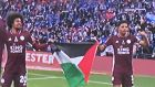 Wesley Fofana and Hamza Choudhury with a Palestinian flag after their FA Cup final win over Chelsea. Photograph: Twitter