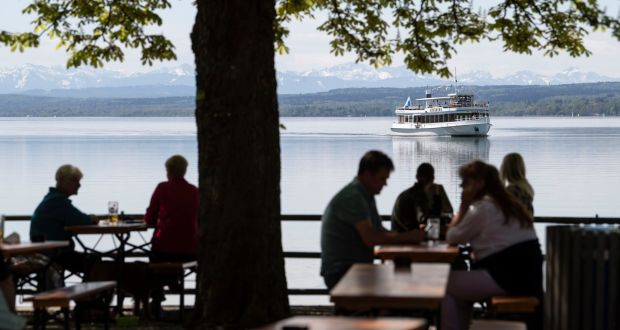 An excursion boat passes a beer garden in Inning on the Ammersee near Munich, Germany, on May 10th. Photograph: Lukas Barth-Tuttas/EPA