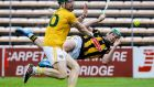 Killenny's Eoin Cody is challenged by Antrim's Niall McKenna. Photograph: Lorraine O'Sullivan/Inpho