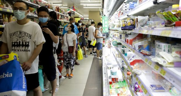 People wait in line at a busy supermarket in Taipei, Taiwan, on Saturday. Photograph: I-Hwa Cheng/Bloomberg