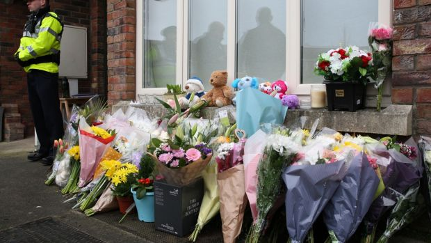 Flowers are seen outside the home of Andrew McGinley and Deirdre Morley following the deaths of their three children. Photograph: Stephen Colllins/Collins.