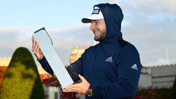 Last year, Tyrrell Hatton held the BMW PGA Championship trophy in his hoodie in Wentworth.  Photo: Ross Kinnaird / Getty Images