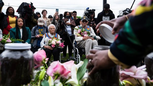 Viola Fletcher (centre left) and Hughes Van Ellis (centre right), survivors of the 1921 Tulsa race massacre, attend a soil collection ceremony to honour the remaining unknown victims of the massacre. Photograph: Joshua Rashaad McFadden/The New York Times