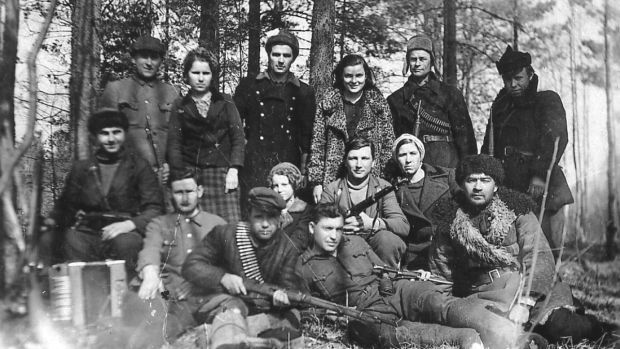 An undated photograph by Faye Schulman of herself, third from right in back row, with fellow partisans. Photograph: Faye Schulman