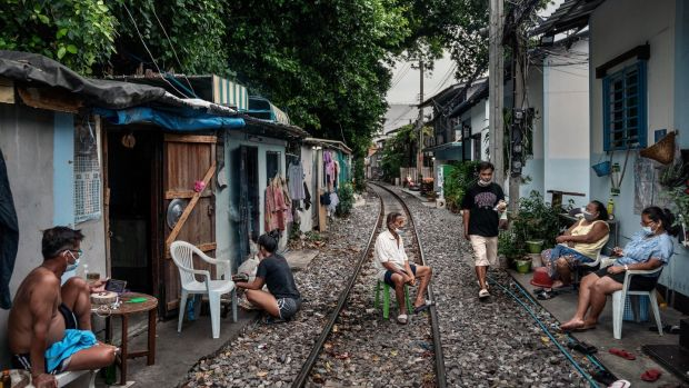 People who live along railroad tracks in part of the Klong Toey slum, Bangkok. Photograph: Adam Dean/The New York Times