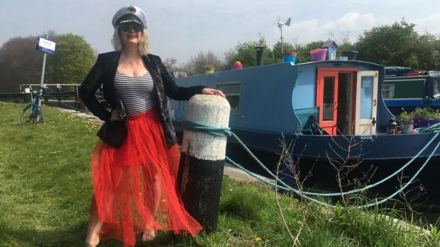 Claire Beck standing next to her boat. Photograph: Claire Beck