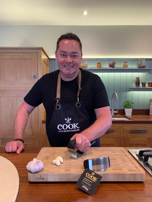 Neven Maguire with his best selling garlic press in the range at Dunnes Stores