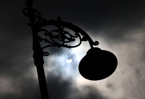 SOLAR ECLIPSE: A lamp post silhouetted against the sky at North Wall Quay in Dublin as Thursday's partial solar eclipse occurred. Eclipses take place when the sun, moon and Earth align for a brief period, casting some degree of shadow across parts of the planet. The last one in Ireland was in 2017. Photograph: Alan Betson