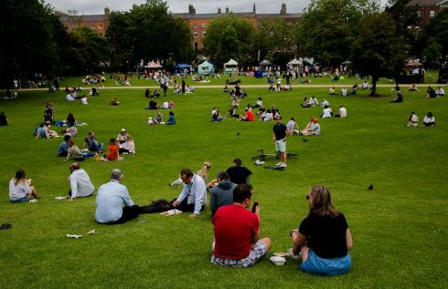 FRESH AIR: Groups of people enjoying the good weather and outdoors in Merrion Square, Co Dublin. Photograph: Gareth Chaney/Collins