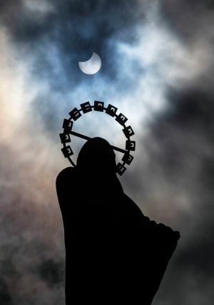 SOLAR ECLIPSE: A statue of Our Lady, Star of the Sea on Bull Wall, Co Dublin, is silhouetted against the sky during Thursday's partial solar eclipse. Photograph: Brian Lawless/PA Wire