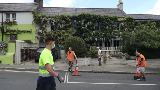 People work during the week on transforming Enniskerry village in Co Wicklow into part of the Disenchanted film set, where Disney are filming. Photograph: Niall Carson/PA Wire