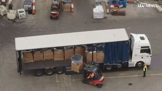 ITV News cameras film pallets piled with unwanted goods being unloaded at a waste recycling site near to Amazon's Dunfermline warehouse. Photograph: ITV News