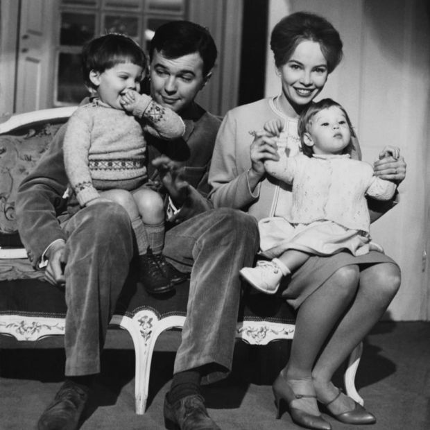 Caron and Peter Hall with their children, Christopher (left) and Jennifer, in 1959: 'He wanted me in the kitchen preparing sandwiches for him. I just couldn't accept the situation.' Photograph: Chris Ware/Keystone Features/Hulton Archive/Getty