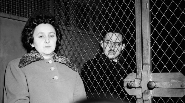 Ethel and Julius Rosenberg sitting in police van after being convicted of espionage.