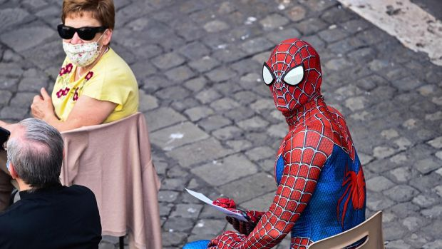 Mattia Villardita wearing a Spider-Man costume waiting for the Pope's arrival at San Damaso courtyard in the Vatican. Photograph: Alberto Pizzoli/AFP via Getty