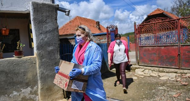 A nurse carries Pfizer BioNTech vaccines against Covid-19 in the remote village of Poienita Voinii, Romania in May. Photograph:  Daniel Mihailescu/AFP via Getty Images