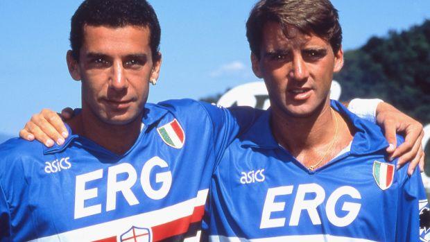 Gianluca Vialli della Sampdoria abbraccia Roberto Mancini in campo nella stagione 1991. File Image: Getty