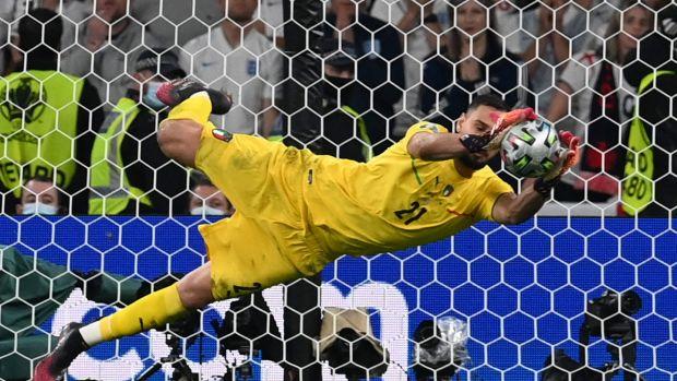 Italy's goalkeeper Gianluigi Donnarumma saves a shot by England's forward Jadon Sancho in the penalty shootout. Photograph: Paul Ellis/Pool/AFP via Getty