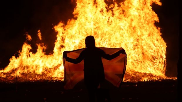 """The huge bonfire in Craigyhill, Larne, is lit on the """"Eleventh night"""" to usher in the Twelfth commemorations. Photograph: Niall Carson/PA Wire"""