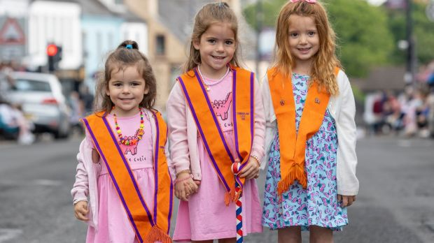 Sisters Amelia (3), and Anna Newell (5), with their cousin Faith Newell (4) from Kilkeel, Co Down, at the annual Twelfth of July celebrations on Monday. Photograph: Liam McBurney/PA Wire