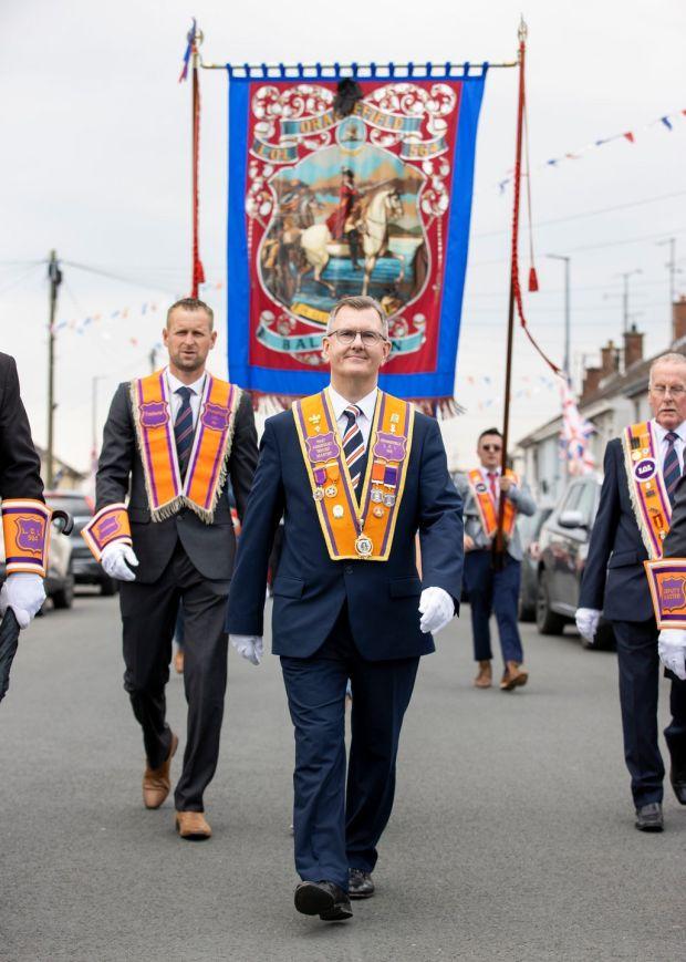 DUP leader Jeffrey Donaldson marches as a member of Ballinran Orange Lodge through Kilkeel, Co. Down. Photograph: Liam McBurney/PA Wire
